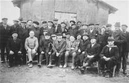 <p>A group of foreign-born Jews poses for a photo in Gurs, a French internment camp in southwestern France. Gurs, France, 1941.</p> <p>Samuel Liebermensch is pictured at the center. Hugo Mayer is seated on the lower right. Siegfried Lindheimer is pictured in the first row , second from the left.</p>
