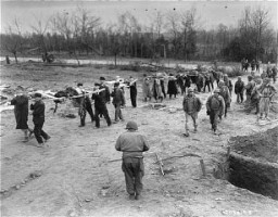 <p>Under the supervision of the US First Army, German civilians from Nordhausen carry victims of the Dora-Mittelbau concentration camp to mass graves. Germany, April 14, 1945.</p>