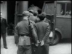 <p>France signed an armistice with Germany on June 22, 1940, recognizing the right of German authorities to oversee the French administration. Further, German military authorities held jurisdiction over matters of internal security. In this footage, a German military court in Paris tries French citizens charged with resisting measures of the military occupation. Despite harsh military justice, the Germans could not quell opposition in France, and resistance activities would reach a peak during the Allied invasion of France in June 1944.</p>