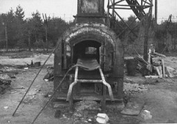 """<p>The remains of a crematorium at the <a href=""""/narrative/4549"""">Bergen-Belsen</a> concentration camp. This photograph was taken after the liberation of the camp in 1945. Bergen-Belsen, Germany, date uncertain.</p>"""