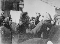 Clandestine photograph taken by George Kadish: scene during the deportation of Jews from the Kovno ghetto. [LCID: 81088]
