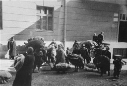 <p>Macedonian Jews leave the Tobacco Monopoly transit camp in Skopje for the deportation trains. Skopje, Yugoslavia, March 1943.</p>
