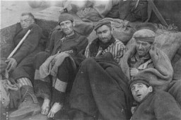 "<p>Survivors of the <a href=""/narrative/7988/en"">Wöbbelin</a> camp wait for evacuation to an American field hospital where they will receive medical attention. Germany, May 4-6, 1945.</p>"