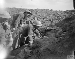 <p>British troops in a trench cover the bodies of two fellow soldiers killed during the Battle of the Somme, November 1916. © IWM (Q 4393)</p>