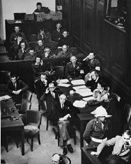"""<p>The French prosecution table at the <a href=""""/narrative/9366"""">International Military Tribunal trial</a> of war criminals at Nuremberg.</p>"""