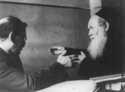 <p>Yitzhak Gitterman (left), Joint Distribution Committee (JDC) director in Warsaw, meets with the representative of an Orthodox Jewish organization. Warsaw, Poland, date uncertain.</p>