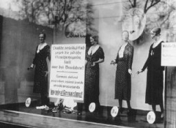 "<p>A boycott sign posted on the display window of a Jewish-owned business reads: ""Germans defend yourselves against Jewish atrocity propaganda. Buy only at German shops!"" Berlin, Germany, April 1, 1933.</p>"