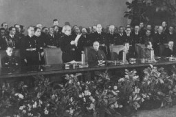 "<p>Slovak prime minister Vojtech Tuka (front row, standing) announces Slovakia's entry into the <a href=""/narrative/3343"">Axis alliance</a> (initially Germany, Italy, and Japan; also joined by Hungary, Romania, and Bulgaria). Berlin, Germany, November 1940.</p>"