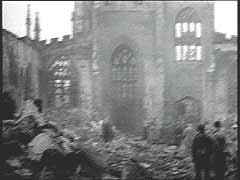 <p>On the night of November 14-15, 1940, almost 500 German bombers attacked the British industrial city of Coventry in central England. The bombers dropped 150,000 incendiary bombs and more than 500 tons of high explosives. The air raid destroyed much of the city center, including 12 armament factories and the historic Saint Michael's Cathedral. This footage shows scenes from the aftermath of the attack. The bombing of Coventry came to symbolize, to Britain, the ruthlessness of modern air warfare.</p>