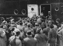 "<p>The <em>St. Louis</em>, carrying German Jewish refugees denied entry into <a href=""/narrative/10734"">Cuba</a> and the United States, arrives in Antwerp. Belgian police guard the gangway to prevent passengers' relatives from boarding the ship. Belgium, June 17, 1939.</p>"