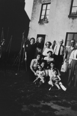 """<p>The Anciaux family with Annie and Charles Klein (front), <a href=""""/narrative/7722"""">Jewish children</a> whom they sheltered during the war. Brussels, Belgium, between 1943 and 1945.</p> <p>Carle Enelow and Yettanda Stewart (born Charles and Annie Klein) were Jewish siblings who were <a href=""""/narrative/7711"""">hidden</a> during the war by the family of Emile Anciaux, a Belgian Catholic. Charles and Annie's parents were deported from <a href=""""/narrative/5497"""">Mechelen</a> (Malines) to <a href=""""/narrative/3673"""">Auschwitz</a>, where they were murdered (their father on October 31, 1942, and their mother on January 15, 1944). After the war the Klein children were taken to a Jewish orphanage in Brussels.</p>"""