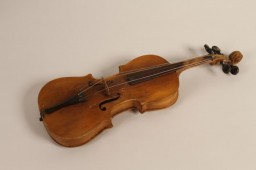 """<p>A childsize violin that belonged to Boruch Golden (Gordon), who was killed along with his mother and brother at the Ponary killing site in September 1943.</p> <p>Boruch was born in 1930, and was one of four children. His parents, <a href=""""/narrative/64092"""">Moshe and Basia Golden</a> (Gordon), raised their family in Swieciany (Svencionys), Lithuania. After the German <a href=""""/narrative/2972"""">invasion of the Soviet Union</a> in June 1941, the family was forced into the Swieciany <a href=""""/narrative/286"""">ghetto</a>. When that ghetto was later liquidated in 1943, the family was sent to the <a href=""""/narrative/3169"""">Vilna </a>ghetto. Later that year, the Vilna ghetto was also liquidated. Boruch, only 13 years old at the time, was murdered at Ponary along with his mother and brother.</p> <p>The violin was saved by his sister, Niusia (now Anna Nodel), who survived the <a href=""""/narrative/2388"""">war</a> in hiding.</p>"""