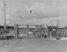 <p>The entrance gate to Kaufering IV subcamp of Dachau. This photograph was taken after liberation. Near Landsberg, Germany, after April 28, 1945.</p>