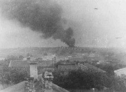 <p>View of Majdanek camp from a nearby village. The smoke could be from the burning of corpses. Poland, October 1943.</p>