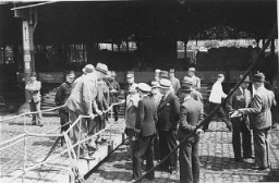 "<p>Belgian officials at the gangplank of the <a href=""/narrative/5063/en""><em>St. Louis</em></a> after the ship was forced to return to Europe from <a href=""/narrative/10734/en"">Cuba</a>. Belgium granted entry to some of the passengers. Antwerp, Belgium, June 1939.</p>"