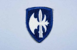 "<p>Insignia of the <a href=""/narrative/8026/en"">65th Infantry Division</a>. The 65th Infantry Division was nicknamed the ""Battle Axe"" after the divisional insignia, a halbert (an axe on a pole), used to cut through the enemy during medieval times.</p>"
