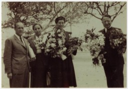 "<p><a href=""https://exhibitions.ushmm.org/americans-and-the-holocaust/personal-story/lois-gunden"" target=""_blank"" rel=""noopener"">Lois Gunden</a> (center right) with other members of the Ville St. Christophe staff in Canet-Plage, France. </p>