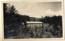 """<p>View of Solahütte, an SS retreat near <a href=""""/narrative/3673"""">Auschwitz</a>.</p> <p><span style=""""font-weight: 400;"""">From <a href=""""/narrative/10876"""">Karl Höcker's photograph album</a>, which includes both documentation of official visits and ceremonies at Auschwitz as well as more personal photographs depicting the many social activities that he and other members of the Auschwitz camp staff enjoyed. These rare images show Nazis singing, hunting, and even trimming a Christmas tree. They provide a chilling contrast to the photographs of thousands of Hungarian Jews deported to Auschwitz at the same time. </span></p>"""