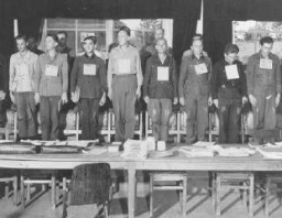 "<p>A group of the 19 men accused of committing atrocities at the <a href=""/narrative/4909"">Dora-Mittelbau</a> concentration camp, located near Nordhausen, during their war crimes trial. Dachau, Germany, September 19, 1947.</p>"