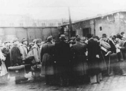 "<p>At the Jozsefvarosi train station in Budapest, Raoul Wallenberg (at right, with hands clasped behind his back) rescues Hungarian Jews from deportation by providing them with protective passes. Budapest, <a href=""/narrative/6229"">Hungary</a>, 1944.</p>"