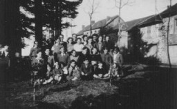 "<p>Group of Jewish children who were sheltered in the children's home Maison des Roches, which was directed by Daniel Trocme (back, center, with glasses). <a href=""/narrative/11043"">Le Chambon-sur-Lignon</a>, France, between 1941 and 1943.</p>"