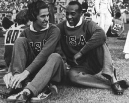 "<p>Members of the US Olympic team—runners Helen Stephens and Jesse Owens—at the Berlin <a href=""/narrative/7139"">Olympic Games</a>. Germany, August 1936.</p>"