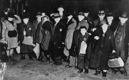 "<p>Jews in the town of Coesfeld, in northwestern Germany, assembled for deportation to the <a href=""/narrative/6400/en"">Riga</a> ghetto. Coesfeld, Germany, December 10, 1941.</p>"