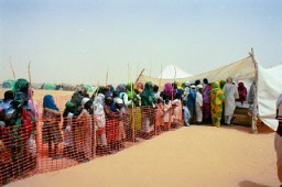 Refugees from Darfur line up in a camp in eastern Chad