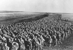 "<p>Column of <a href=""/narrative/10135"">Soviet prisoners of war</a> from the eastern front. Kharkov, Soviet Union, June 18, 1942.</p>"