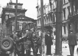 Soviet soldiers in a street in the Soviet occupation zone of Berlin following the defeat of Germany. [LCID: 04814]