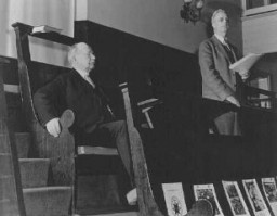 "<p>Rufus Jones (seated) and Clarence Pickett were chairman and executive secretary of the <a href=""/narrative/4339"">American Friends Service Committee</a> (AFSC), respectively. They are pictured here at a Quaker meeting in Philadelphia. The AFSC assisted Jewish and Christian European refugees. Philadelphia, United States, January 22, 1943.</p>"