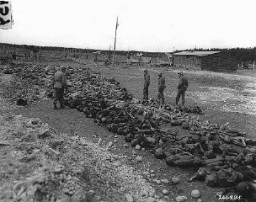 "<p>US troops view bodies of victims of <a href=""/narrative/8071/en"">Kaufering</a> IV, a Dachau subcamp in the Landsberg-Kaufering area. Germany, April 30, 1945.</p>"