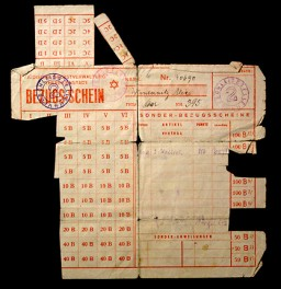 "<p>The Nazis made Jewish leaders responsible for the distribution of food supplies and other necessities allotted to ghetto residents. Due to grossly inadequate supplies, the <em>Juedische Selbstverwaltung Theresienstadt</em> (Jewish Administration of Theresienstadt) issued ration cards such as this one. The columns count points allotted for various goods identified by letters of the alphabet. Boxes were removed as residents exchanged points for food or other goods. This view shows the front of the card. Issued in the <a href=""/narrative/5386/en"">Theresienstadt</a> ghetto, Czechoslovakia, 1944.</p>"