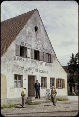 "<p>Exterior view of the ORT (Organization for Rehabilitation through Training) supply and transport building in the <a href=""/narrative/9339/en"">Foehrenwald</a> displaced persons camp. Foehrenwald, Germany, 1953.</p>