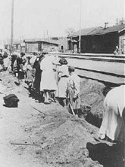 Jewish women deported from Bremen, Germany, are forced to dig a trench at the train station. [LCID: 5124]