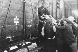 "<p>Jews load a barrel of water onto a deportation train in Skopje. In March 1943, Jews of Macedonia were rounded up and assembled at the Tobacco Monopoly in Skopje, where several building had been converted into a transit camp. <a href=""/narrative/5955/en"">Bulgarian occupation</a> authorities deported them by train to the <a href=""/narrative/3819/en"">Treblinka</a> killing center. Skopje, <a href=""/narrative/6153/en"">Yugoslavia</a>, March 1943.</p>"
