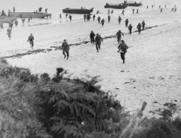 "<p>British troops land on the beaches of Normandy on <a href=""/narrative/2899"">D-Day</a>, the beginning of the Allied invasion of France to establish a second front against German forces in Europe. Normandy, France, June 6, 1944.</p>"