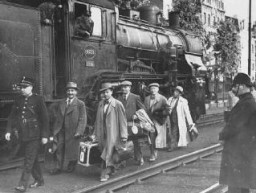 "<p>Belgium agreed to accept some of the Jewish refugee passengers of the <a href=""/narrative/4719""><em>St. Louis</em></a> after Cuba and the US denied them entry. Here, Belgian police escort some of the passengers after their arrival in Antwerp. Belgium, June 17, 1939.</p>"