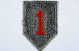 "<p>Insignia of the <a href=""/narrative/7798"">1st Infantry Division</a>. The 1st Infantry Division's nickname, the ""Big Red One,"" originated from the division's insignia, a large red number ""1"" on a khaki field. This nickname was adopted during <a href=""/narrative/28"">World War I</a>, when the 1st was the first American division to arrive in France.</p>"