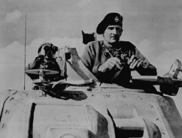 "<p>General Bernard L. Montgomery, commander of British forces in Egypt, watches British tanks move toward German lines during the <a href=""/narrative/10675"">military campaign</a> in North Africa. November 1942.</p>"