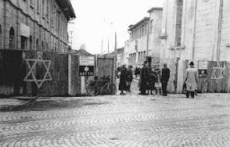 "<p>Guards check the identification papers of women entering the <a href=""/narrative/286/en"">ghetto</a> in <a href=""/narrative/7627/en"">Munkacs</a>, in a part of Czechoslovakia annexed by <a href=""/narrative/6206/en"">Hungary</a> in 1938. Czechoslovakia, 1944.</p>"
