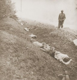 <p>Execution of Polish prisoners of war near Ciepielow in September 1939. Some of the 300 Polish POWs who were executed here by firing squad are visible. In the background is a Wehrmacht soldier who participated. Ciepielow, Radom, Poland, September 1939.</p>