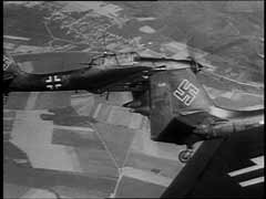 "<p>The Junkers (Ju) 87, known as the ""Stuka,"" spearheaded the Blitzkrieg (""lightning war"") attacks that were decisive in the western campaign in 1940. Stuka dive-bombers closely supported German forces on the ground. They destroyed enemy strong points, aircraft, and airfields, and spread panic in rear areas. Although slow and easily shot down by Allied fighters, the Stukas proved devastatingly effective in the German invasions of Poland and western Europe, where Germany enjoyed air superiority. Stuka dive-bombers caused terror among Allied ground forces, who came to recognize the telltale shriek of a bomber's dive. This German newsreel footage shows (from both the air and the ground) destruction caused by Stuka attacks during the western campaign in Flanders.</p>"