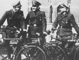 <p>Three SS officers at the Breendonk internment camp: from left, First Lieutenant Hans Kantschuster, Master Sergeant Walter Mueller, and Second Lieutenant Artur Prauss. Breendonk, Belgium, between 1940 and 1944.</p>