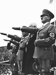 "<p>Adolf Hitler salutes the Olympic flag at the opening of the <a href=""/narrative/7139/en"">Olympic Games</a> in Berlin. Germany, August 1, 1936.</p>"