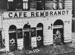 "<p>A Jewish-owned cafe in <a href=""/narrative/6000"">Vienna</a> that was defaced with antisemitic graffiti. Vienna, Austria, November 1938.</p>"