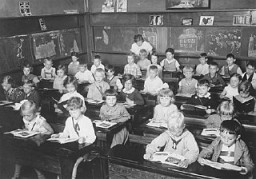 First grade pupils, both Jewish and non-Jewish, study in a classroom in a public school in Hamburg.