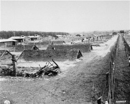 "<p>View of barracks after the liberation of <a href=""/narrative/8071"">Kaufering</a>, a network of subsidiary camps of the Dachau concentration camp. Landsberg-Kaufering, Germany, April 29, 1945.</p>"