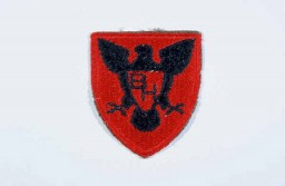 """<p>Insignia of the <a href=""""/narrative/7833/en"""">86th Infantry Division</a>. The 86th Infantry Division developed the blackhawk as its insignia during <a href=""""/narrative/28/en"""">World War I</a>, to honor the Native American warrior of that name who fought the US Army in Illinois and Wisconsin during the early nineteenth century. The nickname """"The Blackhawks"""" or """"Blackhawk"""" division is derived from the insignia.</p>"""