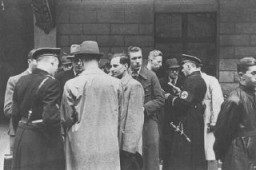 """<p>SS and Nazi police prepare for a raid on the Jewish community offices in <a href=""""/narrative/6000/en"""">Vienna</a>. Austria, March 18, 1938.</p>"""